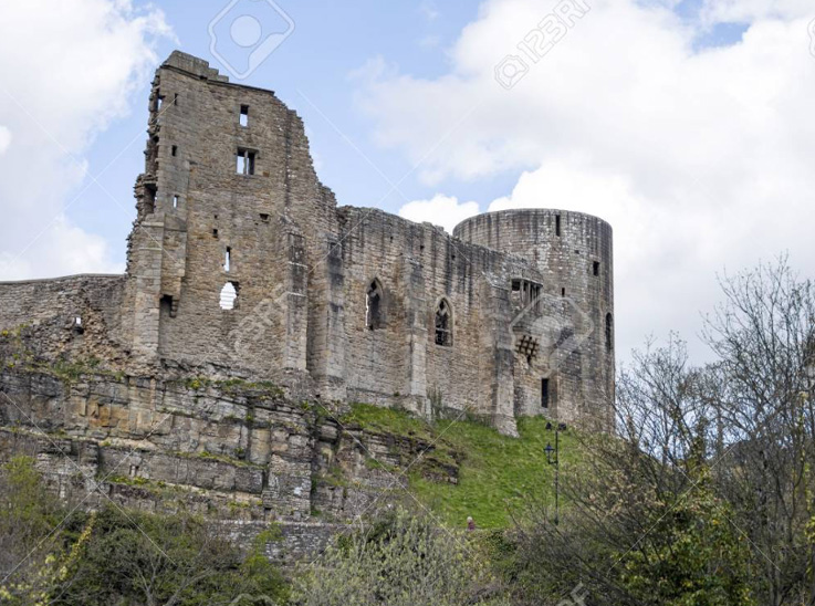 ruined walls and a tower of a medieval castle